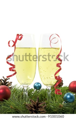 Two Glass of Champagne,  Christmas Balls and Pine Tree branch over a on white background