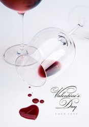 Two glasses and spilled wine