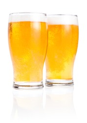 Two glasses fresh lager beer with foam Isolated on white background