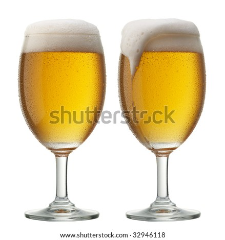 two glasses of beer, one of them is overflowing - stock photo