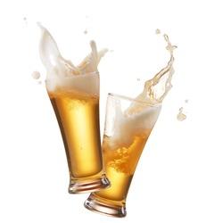two glasses of beer toasting creating splash