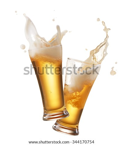 two glasses of beer toasting creating splash #344170754