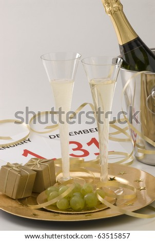 Two glasses of champagne and New Year's Eve decoration