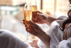 two glasses of champagne in the hands of the bride and groom