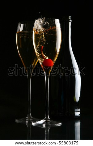 two glasses of champagne on black