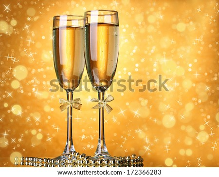 Two glasses of champagne on bright background with lights #172366283