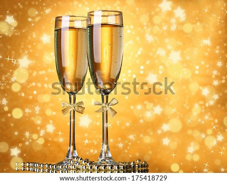 Two glasses of champagne on bright background with lights #175418729