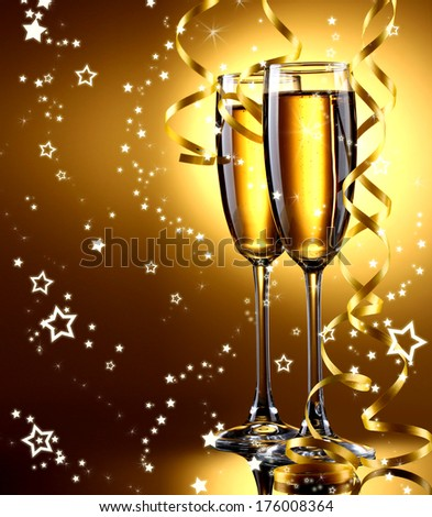 Two glasses of champagne on bright background with lights #176008364