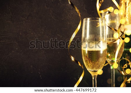 Two glasses of champagne on celebration background #447699172