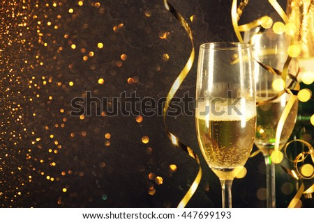 Two glasses of champagne on celebration background - Shutterstock ID 447699193