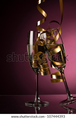Two glasses of champagne on pink background - stock photo