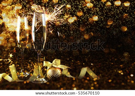 Two glasses of champagne over blur spots lights background. Celebration concept, free space for text #535670110