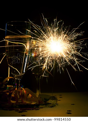 Two glasses of champagne with burnning sparkler