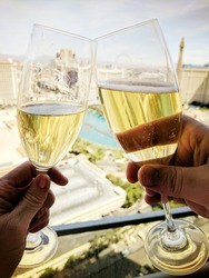 two glasses of champagne with las vegas strip in the background