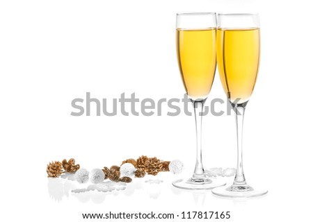 Two glasses of champagne with New Year's decor