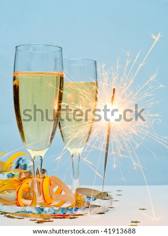 Two glasses of champagne with ribbons and burnning sparkler