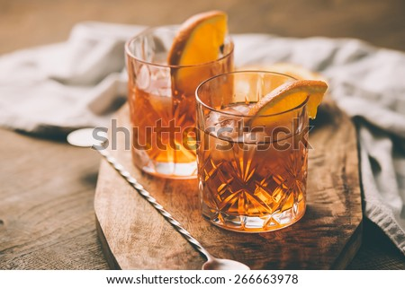 Two glasses of cocktail with orange slice. Toned image