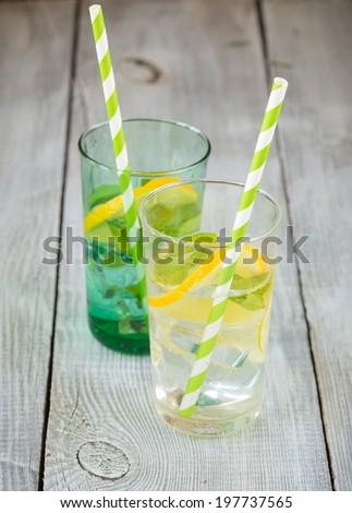 Two glasses of lemonade and colored paper straws