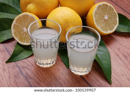 two glasses of limoncello, lemon liqueur - stock photo
