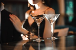 Two glasses of martini coctail in a bar