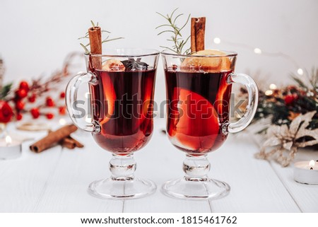 Two glasses of mulled wine on the table surrounded by New Year's lights. Festive mood Stockfoto ©