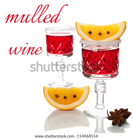 Two glasses of mulled wine, spices and orange slices