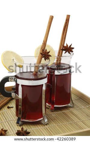 Two glasses of mulled wine with spices on wooden tray. Isolated on white background. - stock photo