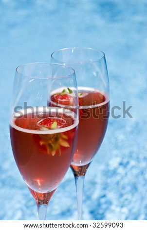 Two Glasses of Pink Champagne and Strawberries by the Swimming Pool