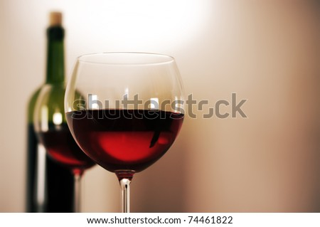 Two glasses of red wine and wine bottle.