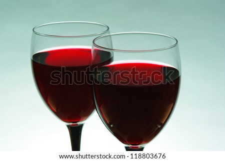 Two glasses of  red wine. Blue background - stock photo