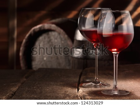 Two glasses of red wine on a table in a vintage beer cellar