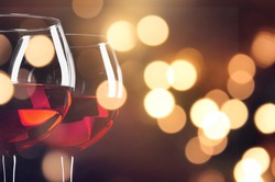 Two glasses of red wine on bokeh background