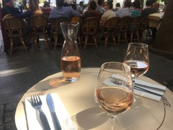 Two glasses of rosé wine and a carafe at a French brasserie in Paris.