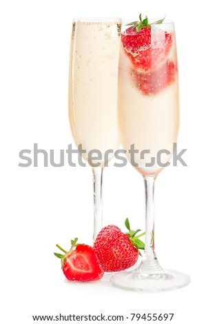 Two glasses of sparkling wine (champagne) and strawberry on white