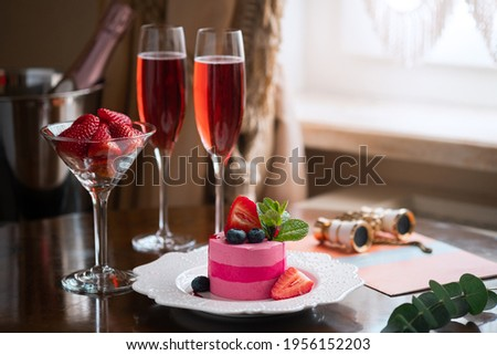 Two glasses of sparkling wine or champagne and strawberries in the theater buffet, intermission at the performance Stock photo ©