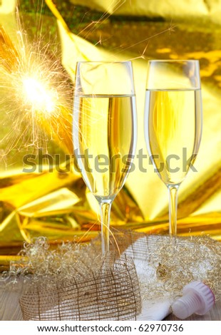 two glasses of sparkling wine with sparkler
