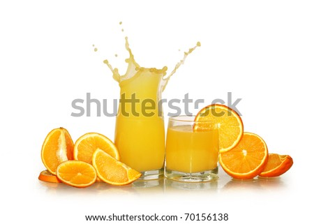 Two glasses of splashing orange juice and fruits isolated on white background with clipping path