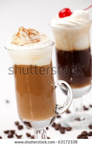 Two glasses of tasty Coffee Cocktails with whipped cream and maraschino cherry - Coffee Warmers series