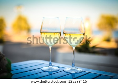 two glasses of tasty white wine at sunset #125299415