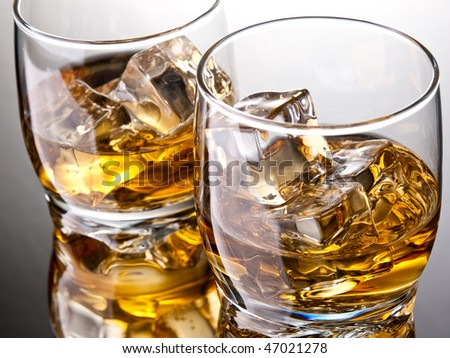 Two glasses of whiskey and ice