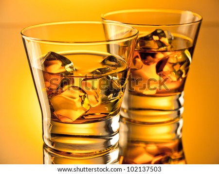 Two glasses of whiskey in vivid colors
