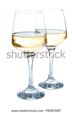 Two glasses of white wine on a white background