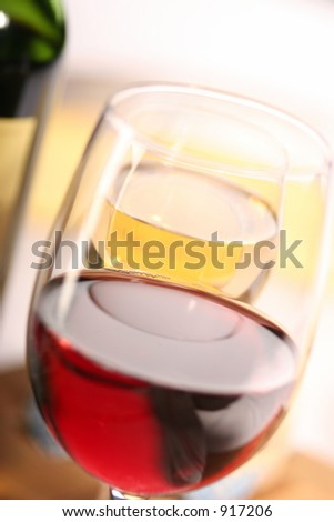 two glasses of wine and a part of a bottle, close up, macro, soft focus