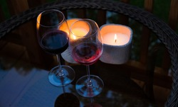 Two glasses of wine in the dark