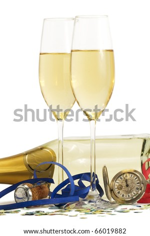 two glasses with champagne, old pocket watch, streamer, cork and confetti in front of a champagne bottle on white background
