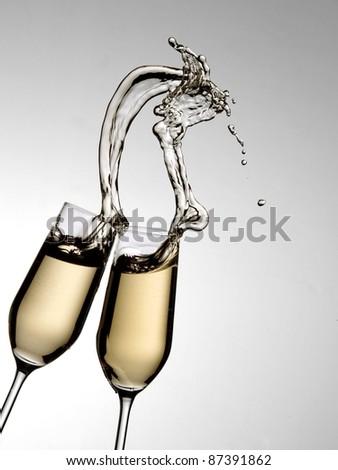 Two glasses with champagne splash