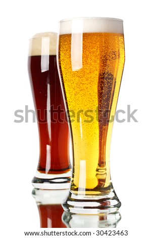 Two glasses with dark and light beer on a white background
