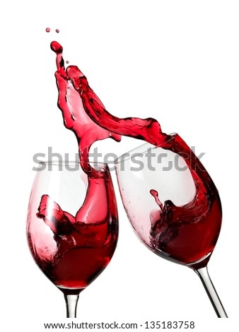 Two glasses with red wine splash