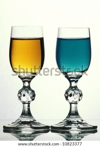 Two glasses with yellow and blue liquid