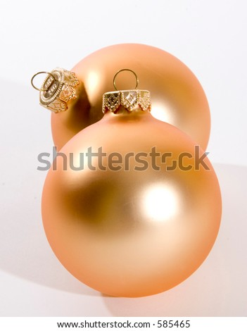 two gold christmas tree ornaments